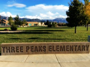 "Picture of the ""Three Peaks Elementary"" sign"